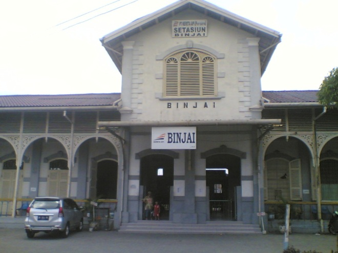 My mother and my nephew posed in the front of Binjai Station