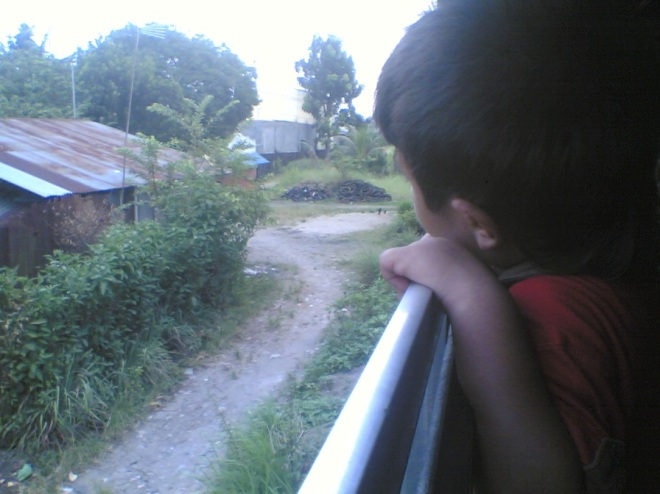 My little nephew on the open window, who was absolutely enjoying every moment during the train journey
