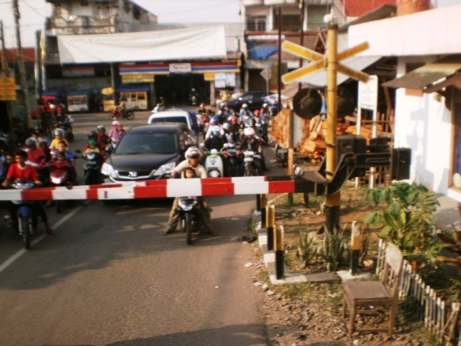 A railway intersection...traditional Indonesian pole, red and white :)