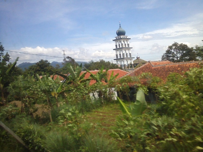 Country Life : The village residence with a mosque tower in the center