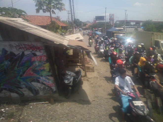Busy street in Karawang, too many motorcycles for my liking